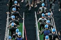 05 AUG 2007 - LONDON, UK - Age group competitors make their way down the ramp to their race start - London Triathlon. (PHOTO (C) NIGEL FARROW)
