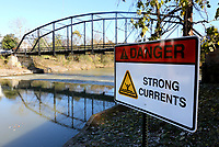 NWA Democrat-Gazette/DAVID GOTTSCHALK One of six strong currents warning signs is visible Friday, November 1, 2019, on the bank of the War Eagle creek at the War Eagle Mill. The signs, were placed by Benton County and Bob Tharp, the mayor of Decatur, in a collaborated project to bring awareness of the dangerous currents on the creek. Bob Tharp and his wife Joy's Ross died in a floating accident at the dam on the river in June of this year.