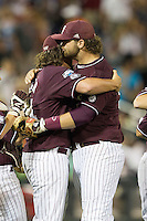 Mississippi State first baseman Wes Rea (35) hugs teammate Jonathan Holder (14) at the end of the game against the Indiana Hoosiers in Game 6 of the 2013 Men's College World Series on June 17, 2013 at TD Ameritrade Park in Omaha, Nebraska. The Bulldogs defeated Hoosiers 5-4. (Andrew Woolley/Four Seam Images)