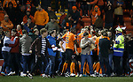 Dundee Utd fans spill onto the pitch to reach Blair Spittal after his free-kick goal won the game for the visitors