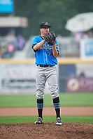 Akron RubberDucks starting pitcher Jake Paulson (45) looks in for the sign during a game against the Harrisburg Senators on August 19, 2018 at FNB Field in Harrisburg, Pennsylvania.  Akron defeated Harrisburg 3-0 in a rain shortened game.  (Mike Janes/Four Seam Images)