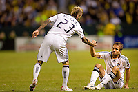 LA Galaxy midfielder David Beckham helps up teammate Mike Magee after being knocked down during the Western Conference Final. The LA Galaxy defeated the Houston Dynamo 2-1 to win the MLS Western Conference Final at Home Depot Center stadium in Carson, California on Friday November 13, 2009.....