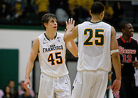 Cody Doolin of USF gives high fives with Cole Dickerson of USF during the game against St. John's at War Memorial Gym in San Francisco, California on December 4th, 2012.   USF Dons defeated St. John's, 81-65.
