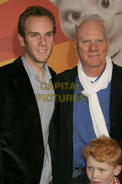"CHARLIE McDOWELL & MALCOLM McDOWELL .""Bolt"" Disney World Premiere held at the El Capitan Theatre, Hollywood, California, USA..November 17th, 2008.half length black jacket white scarf blue  father son dad .CAP/ADM/MJ.©Michael Jade/AdMedia/Capital Pictures."