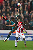 30th September, bet365 Stadium, Stoke-on-Trent, England; EPL Premier League football, Stoke City versus Southampton; Southampton's Ryan Bertrand and Stoke City's Mame Biram Diouf fight over a high ball