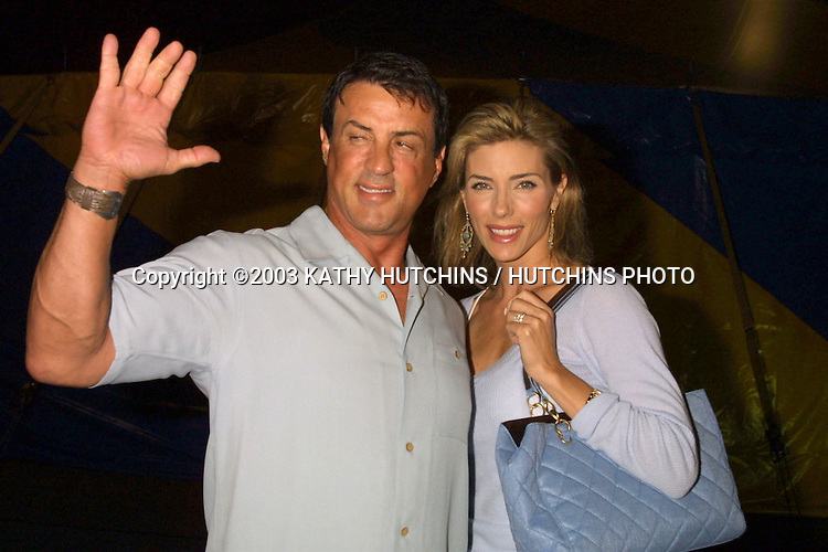 "©2003 KATHY HUTCHINS / HUTCHINS PHOTO.STAPLES CENTER PARKING LOT.LOS ANGELES, CA.OPENING NIGHT OF CIRQUE DE SOLIEL'S NEW SHOW.""VAREKAI"".September 12, 2003..SLYVESTER STALLONE.WIFE JENNIFER FLAVIN"
