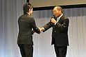 (L-R) Toshiaki Nishioka, Guts Ishimatsu,.JANUARY 25, 2012 - Boxing :.Toshiaki Nishioka receives the OK! Award from Guts Ishimatsu during the Japan's Boxer of the Year Award 2011 at Tokyo Dome Hotel in Tokyo, Japan. (Photo by Hiroaki Yamaguchi/AFLO)