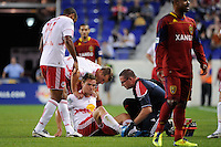 Chris Albright (3) of the New York Red Bulls is treated by a trainer during a Major League Soccer (MLS) match against Real Salt Lake at Red Bull Arena in Harrison, NJ, on September 21, 2011.