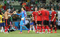 Man of The Match Mexican Goalkeeper Guillermo Ochoa Is congratulated at the End of the Game  by Giovani dos Santos