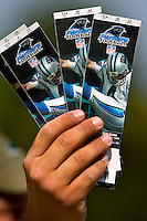 09/16/07 :  Tickets for sale before a Carolina Panther game. The Carolina Panthers, professional American NFL football team that represents both North Carolina and South Carolina, is based in Charlotte, North Carolina. The Panthers began playing in 1995 as part of the National Football League?s expansion program. They are members of the National Football Conference (NFC) South Division. They play in the Bank of America Stadium, located in downtown Charlotte.