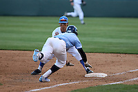 Brett Urabe (44) of the UCLA Bruins takes the throw at first base ahead of Kyle Datres (8) of the North Carolina Tar Heels during a game at Jackie Robinson Stadium on February 20, 2016 in Los Angeles, California. UCLA defeated North Carolina, 6-5. (Larry Goren/Four Seam Images)