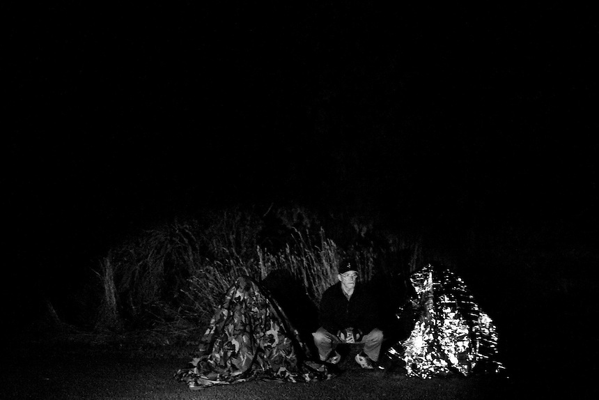 Members of the Idaho Light Foot Militia test using different methods of camouflage in the dark, trying to gauge what is least visible to an enemy with thermal imaging equipment in Dover, Idaho. .