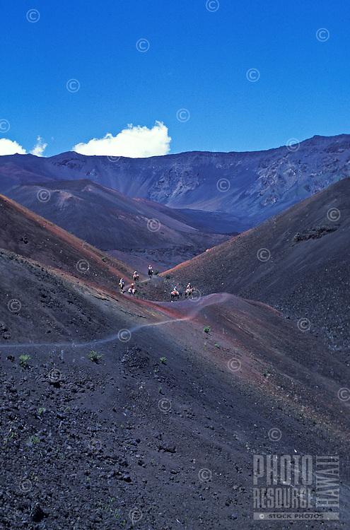 People horsebackriding on a pack-trip at Haleakala crater, Maui