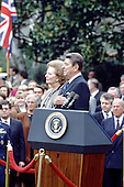 United States President Ronald Reagan, right, hosts a welcoming ceremony for Prime Minister Margaret Thatcher of Great Britain on the South Lawn of the White House in Washington, D.C. on Wednesday, November 16, 1988.  Thatcher died from a stroke at 87 on Monday, April 8, 2013..Credit: Ron Sachs / CNP