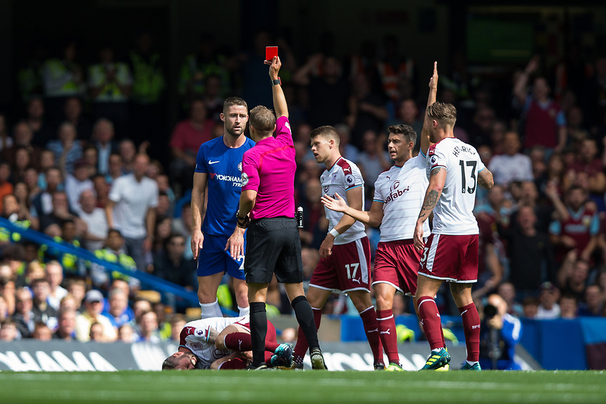 Chelsea's Gary Cahill is shown a red card by Referee Craig Pawson after a challenge on Burnley's Steven Defour<br /> <br /> Photographer Craig Mercer/CameraSport<br /> <br /> The Premier League - Chelsea v Burnley - Saturday August 12th 2017 - Stamford Bridge - London<br /> <br /> World Copyright &copy; 2017 CameraSport. All rights reserved. 43 Linden Ave. Countesthorpe. Leicester. England. LE8 5PG - Tel: +44 (0) 116 277 4147 - admin@camerasport.com - www.camerasport.com