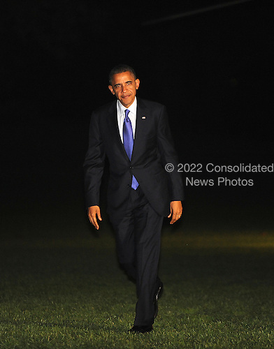 United States President Barack Obama walks on the South Lawn of the White House on October 17, 2012 in Washington, DC. Obama was returning from Iowa and Ohio after speaking at campaign rallies.  .Credit: Olivier Douliery / Pool via CNP