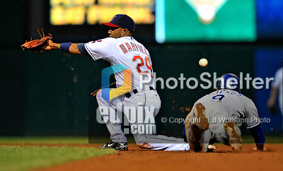 13 September 2008: Cleveland Indians' infielder Josh Barfield is unable to get the throw to get David DeJesus out during game action against the Kansas City Royals at Progressive Field in Cleveland, Ohio. The Royals defeated the Indians 8-4 in the second game, sweeping their double-header...Mandatory Photo Credit: Ed Wolfstein Photo