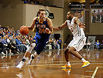 SIOUX FALLS, SD - NOVEMBER 26:  Mike Daum #24 from South Dakota State University gets a step past Isaac Banks #10 from East Tennessee State University during their game at the Sanford Pentagon Saturday evening in Sioux Falls. (Photo by Dave Eggen/Inertia)