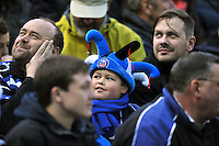 A general view of a young Bath supporter in the crowd. Aviva Premiership match, between Bath Rugby and Northampton Saints on May 2, 2014 at the Recreation Ground in Bath, England. Photo by: Patrick Khachfe / Onside Images