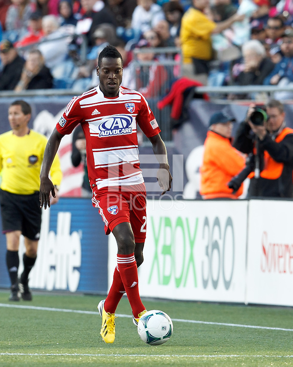 FC Dallas substitute midfielder Je-Vaughn Watson (27) dribbles down the wing..  In a Major League Soccer (MLS) match, FC Dallas (red) defeated the New England Revolution (blue), 1-0, at Gillette Stadium on March 30, 2013.