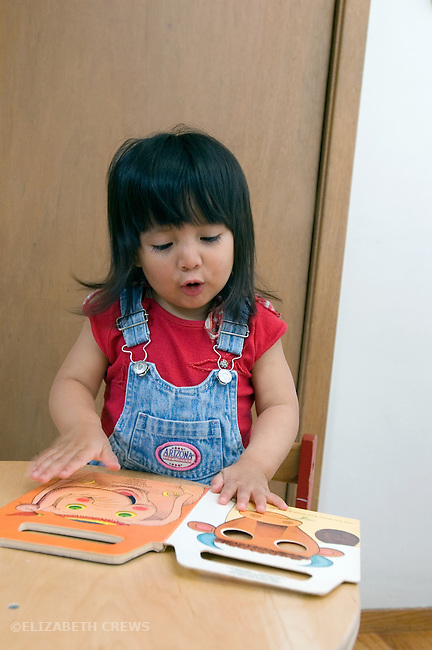 "Berkeley CA Girl, Guatemalan, two-years-old, making ""moo"" sound to accompany picture of cow  MR"