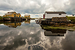 The cloudy sky reflects in the Barbour Tickle, Newtown, Newfoundland, Canada.
