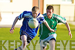 Na Gaeil's David Ross and Renard's Dara O'Neill.