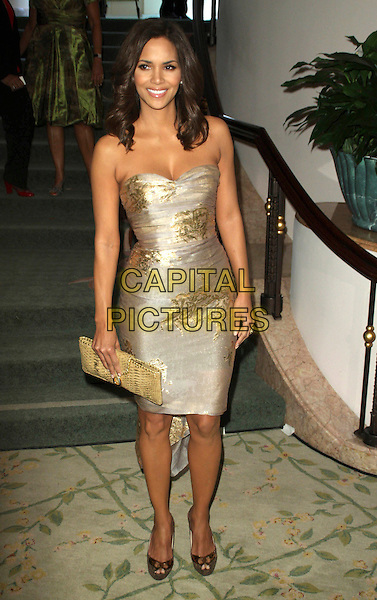 HALLE BERRY .Hosts the ESSENCE Black Women in Hollywood Luncheon held at The Beverly Hills Hotel, Beverly Hills, CA, USA, 19th February 2009..full length strapless gold silver patterned print metallic dress beige clutch bag Christian Louboutin cork platform shoes peep toe .CAP/ADM/KB.©Kevan Brooks/Admedia/Capital PIctures