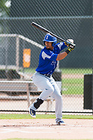 Team Italy third baseman Robel Garcia (12) at bat during an exhibition game against the Oakland Athletics at Lew Wolff Training Complex on October 3, 2018 in Mesa, Arizona. (Zachary Lucy/Four Seam Images)