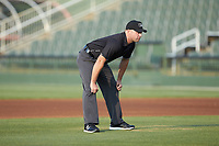 Umpire Colin Baron handles the calls on the bases during the South Atlantic League game between the Delmarva Shorebirds and the Kannapolis Intimidators at Kannapolis Intimidators Stadium on June 4, 2019 in Kannapolis, North Carolina. The Intimidators defeated the Shorebirds 9-0. (Brian Westerholt/Four Seam Images)
