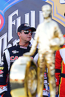 Sept. 14, 2012; Concord, NC, USA: NHRA top fuel dragster driver Steve Torrence near the championship trophy during qualifying for the O'Reilly Auto Parts Nationals at zMax Dragway. Mandatory Credit: Mark J. Rebilas-