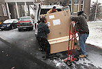 A state buildings and grounds crew unloads the official portrait of Gov. Jim Gibbons outside the Capitol in Carson City, Nev. on Friday, Dec. 17, 2010. .Photo by Cathleen Allison