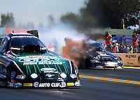 Jul. 27, 2014; Sonoma, CA, USA; NHRA funny car driver Alexis DeJoria during the Sonoma Nationals at Sonoma Raceway. Mandatory Credit: Mark J. Rebilas-