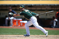 OAKLAND, CA - MAY 29:  Nick Punto of the Oakland Athletics bats against the Detroit Tigers during the game at O.co Coliseum on Thursday, May 29, 2014 in Oakland, California. Photo by Brad Mangin