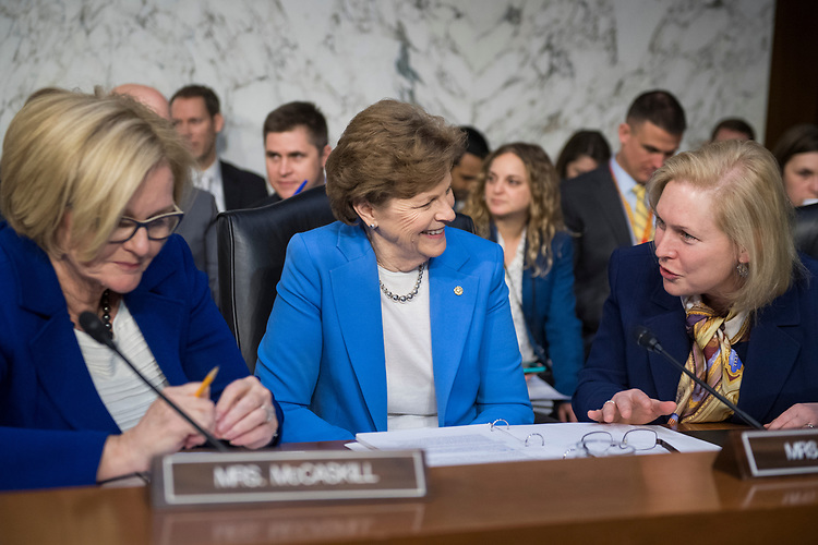 UNITED STATES - FEBRUARY 08: From left, Sens. Claire McCaskill, D-Mo., Jeanne Shaheen, D-N.H., and Kirsten Gillibrand, D-N.Y., talk during a Senate Armed Services Committee hearing on nominations in Hart Building on February 8, 2018. (Photo By Tom Williams/CQ Roll Call)