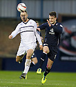 Raith Rovers' Gordon Smith and Dundee's Ryan Conroy challenge for the ball.