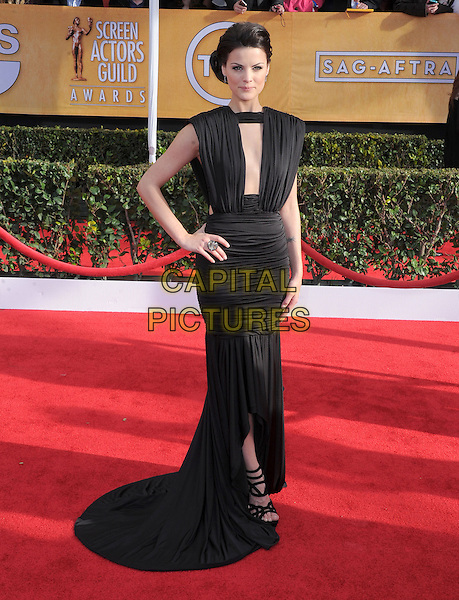 Jaimie Alexander (wearing Marc Bouwer).Arrivals at the 19th Annual Screen Actors Guild Awards at the Shrine Auditorium in Los Angeles, California, USA..27th January 2013.SAG SAGs full length dress black sleeveless ruched fishtail cut out away neckline hand on hip strappy sandals .CAP/DVS.©DVS/Capital Pictures.