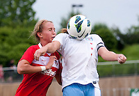 Julia Roberts (13) of the Washington Spirit tries to take the ball away from Lori Chalupny (17) of the Chicago Red Stars during the game at the Maryland SoccerPlex in Boyds, Md.   Chicago defeated Washington, 2-0.