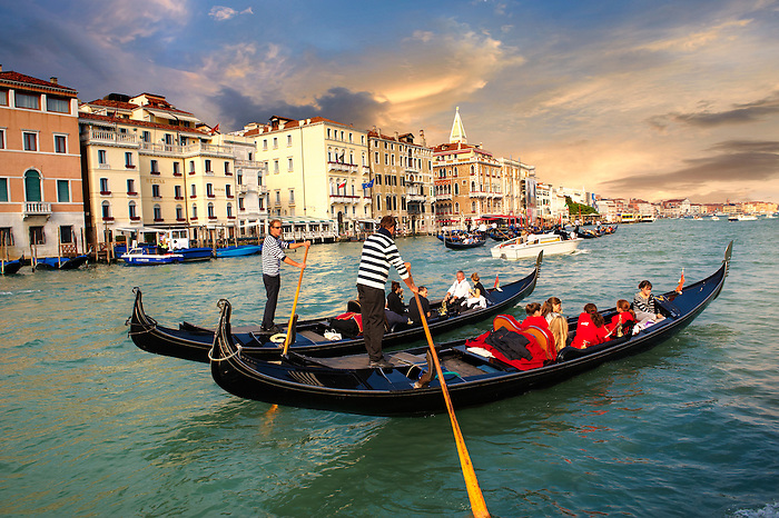 Gondolas on the Grand Canal near St Marks Square at sunset , Venice, Italy