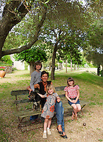 Interior designer Marjolaine Leray with her three children in the garden of their country house in the South of France