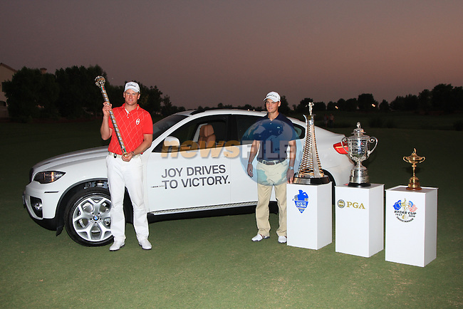 Robert Karlson holding his trophy for winning the Dubai world Championship  ND MARTIN KAYMER PICTURED WITH HIS TROPHYS AND NEW BMW FOR WINNING THE ORDER OF MERIT during the final round of the Dubai World Championship on the Earth Course at the Jumeirah Golf Estate, Dubai..Picture Fran Caffrey/www.golffile.ie.
