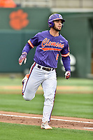 Clemson Tigers first baseman Andrew Cox (6) runs to first base during a game against the Notre Dame Fighting Irish at Doug Kingsmore Stadium on March 11, 2017 in Clemson, South Carolina. The Tigers defeated the Fighting Irish 6-5. (Tony Farlow/Four Seam Images)