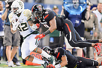 Baylor running back Shock Linwood (32) is pushed out of bounds short of the goal line by Texas Tech defensive back Austin Stewart (8) during NCAA Football game, Saturday, November 29, 2014 in Arlington, Tex. (Mo Khursheed/TFV Media via AP Images)
