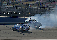 Oct. 10, 2009; Fontana, CA, USA; NASCAR Nationwide Series driver Denny Hamlin (18) crashes after contact with Greg Biffle (16) during the Copart 300 at Auto Club Speedway. Mandatory Credit: Mark J. Rebilas-