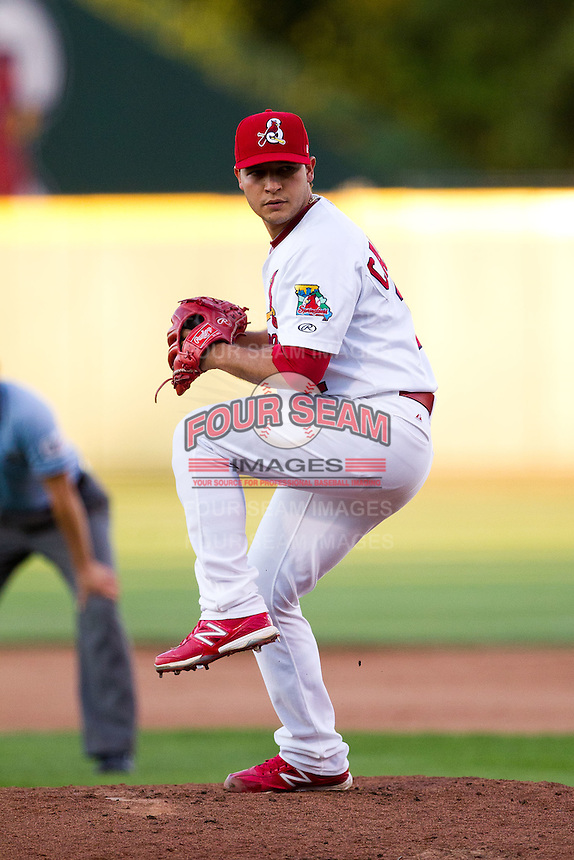 Richard Castillo (12) of the Springfield Cardinals winds up during a game against the Northwest Arkansas Naturals at Hammons Field on June 14, 2012 in Springfield, Missouri. (David Welker/Four Seam Images).