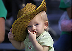 Annmarie Hansen, 17-months, watches the 5th Annual Carson City Bulls, Broncs &amp; Barrels event at Fuji Park, in Carson City, Nev., on Saturday, July 29, 2017. <br />