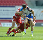 Connacht's Tiernan O'Halloran is tackled by Scarlet's Ken Owens and Olly Barkley<br /> <br /> Rugby - Scarlets V Connacht  - Rabodirect Pro12 - Sunday  30th March  2014 - Parc-y-Scarlets - Llanelli<br /> <br /> &copy; www.sportingwales.com- PLEASE CREDIT IAN COOK