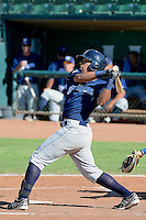 Jalen Harris (16) of the Helena Brewers follows through on his swing against the Ogden Raptors in Pioneer League action at Lindquist Field on July 21, 2013 in Ogden Utah. (Stephen Smith/Four Seam Images)