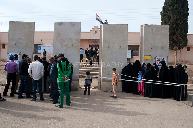 KIRKUK, IRAQ: Turkmen voters gather outside a polling station...Residents of the city of Kirkuk vote for the first time.  Because of violence in the ethnically mixed city, Kirkuk was excluded from the 2005 elections...Photo by Kamaran Najm/Metrography