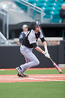 Jacob Marotta (29) of the Bryant Bulldogs follows through on his swing against the Coastal Carolina Chanticleers at Springs Brooks Stadium on March 13, 2015 in Charlotte, North Carolina.  The Chanticleers defeated the Bulldogs 7-2.  (Brian Westerholt/Four Seam Images)